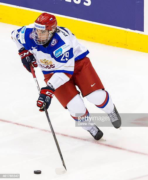 Defenseman Ivan Provorov of Russia moves the puck against Canada during the Gold medal game of the 2015 IIHF World Junior Championship on January 05...