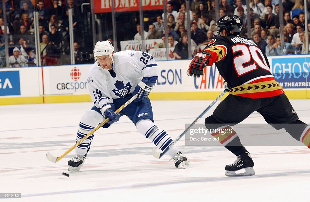 Defenseman Karel Pilar #29 of the Toronto Maple Leafs plays the puck while being defended by left wing Magnus Arvedson #20 of the Ottawa Senators during the game on October 12, 2002 at Air Canada Centre in Toronto, Ontario, Canada.