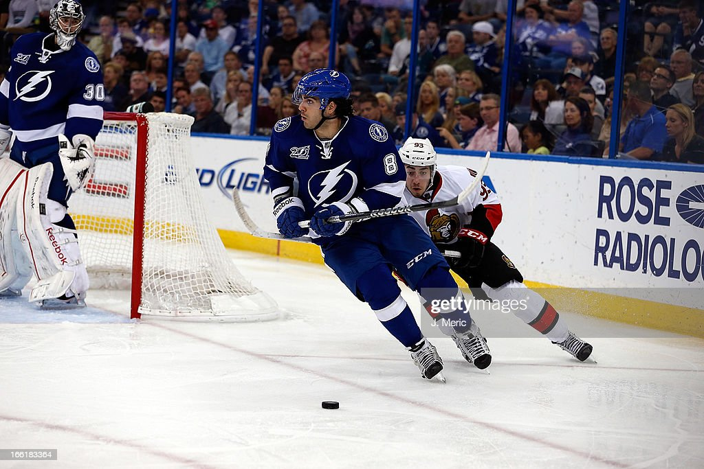 Defenseman Mark Barberio #8 of the Tampa Bay Lightning advances the puck as center <a gi-track='captionPersonalityLinkClicked' href=/galleries/search?phrase=Mika+Zibanejad&family=editorial&specificpeople=7832310 ng-click='$event.stopPropagation()'>Mika Zibanejad</a> #93 of the Ottawa Senators pursues during the game at the Tampa Bay Times Forum on April 9, 2013 in Tampa, Florida.