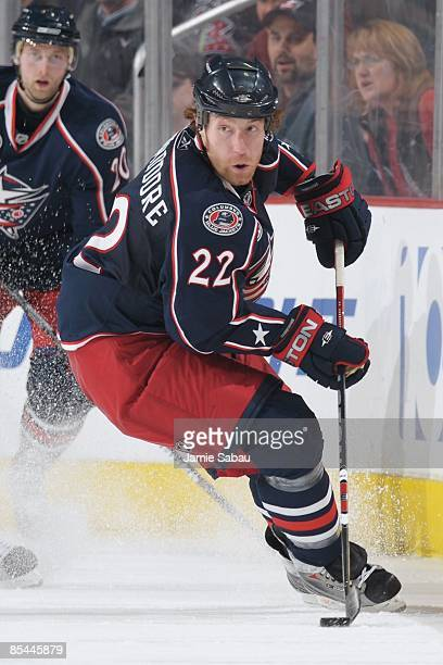 Defenseman Mike Commodore of the Columbus Blue Jackets skates with the puck against the Pittsburgh Penguins on March 12 2009 at Nationwide Arena in...