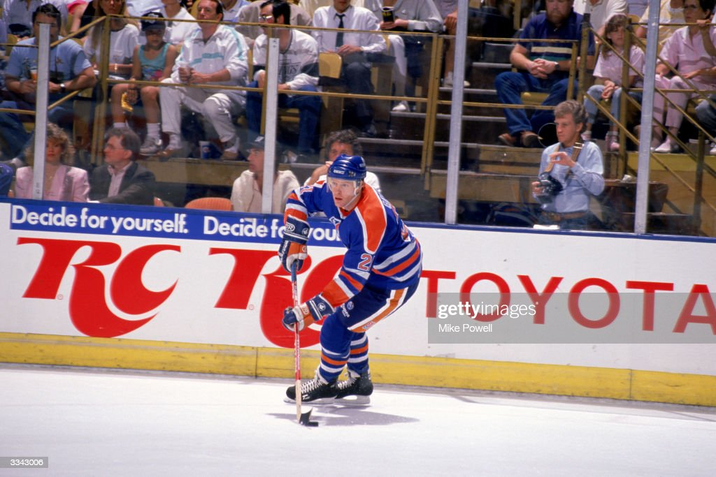 Defenseman Randy Gregg of the Edmonton Oilers looks to pass the puck against the Los Angeles Kings during a 1990 season at the Great Western Forum in...