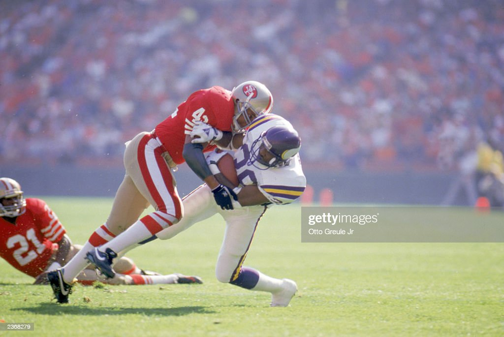 Defenseman Ronnie Lott of the San Francisco 49ers makes a tackle during a NFL game against the Minnesota Vikings at Candlestick Park on October 30...