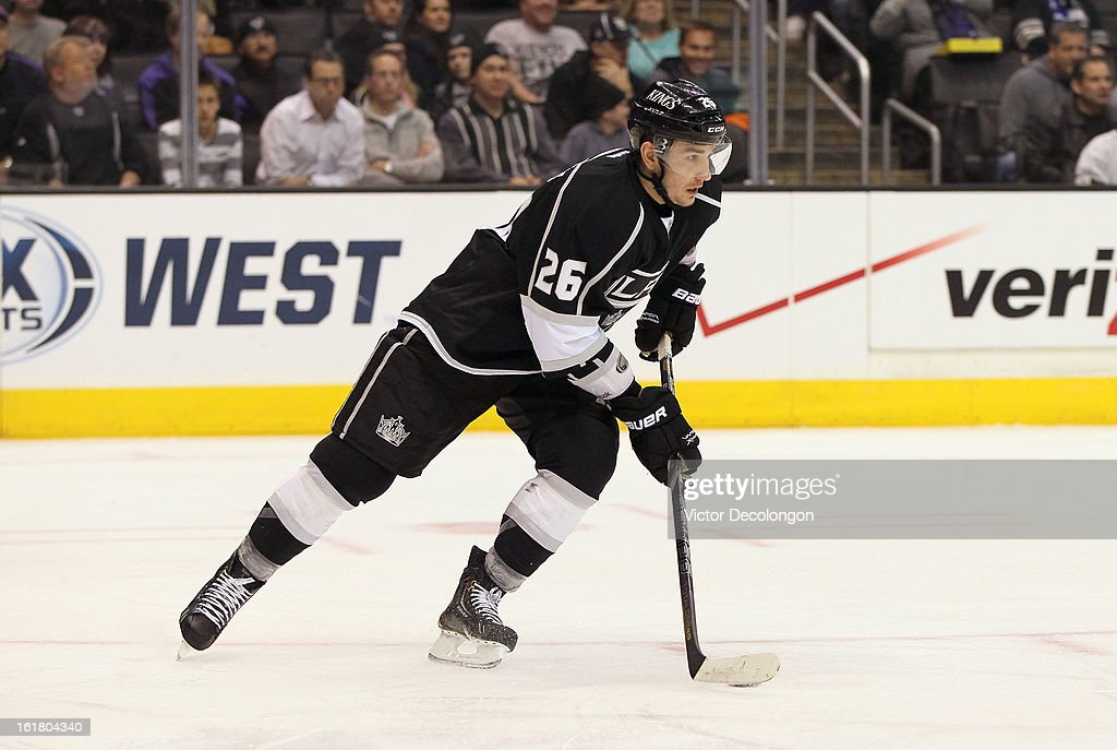Defenseman Slava Voynov #26 of the Los Angeles Kings skates the puck out of the Kings zone during the NHL game against the Columbus Blue Jackets at Staples Center on February 15, 2013 in Los Angeles, California. The Kings defeated the Blue Jackets 2-1.