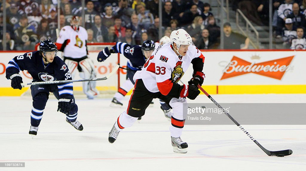 Defenseman Tobias Enstrom #39 of the Winnipeg Jets gives chase as Jakob Silfverberg #33 of the Ottawa Senators carries the puck up the ice during third period action at the MTS Centre on January 19, 2013 in Winnipeg, Manitoba, Canada.