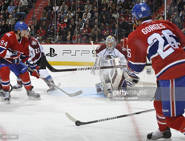 Defensemen Josh Gorges of the Montreal Canadiens makes a pass to teammate right wing Guillaume Latendresse in front of Goaltender Craig Anderson of...
