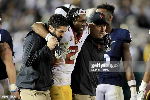 Defensive back Adoree' Jackson of the USC Trojans is helped off the field after suffering an injury in the third quarter against the Penn State...