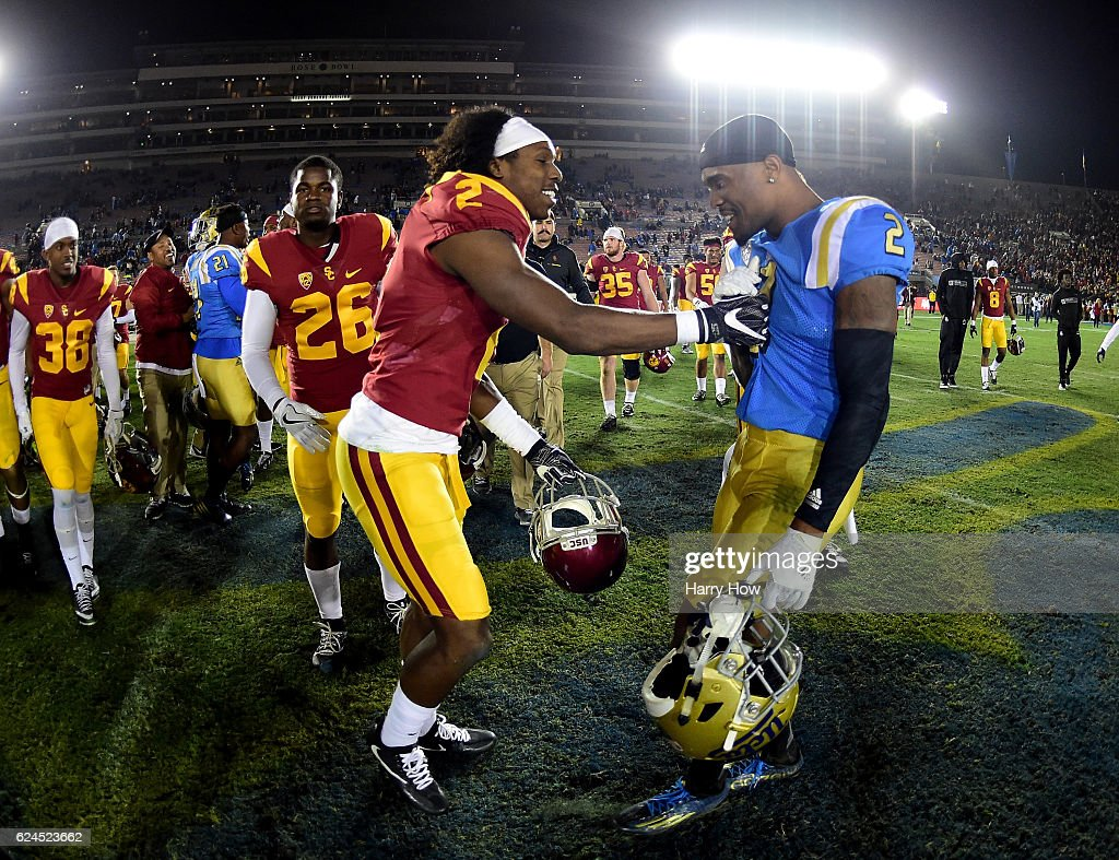 Defensive back Adoree' Jackson #2 of the USC Trojans laughs with defensive back Jaleel Wadood #2 of the UCLA Bruins afer a 36-14 Trojan win at Rose Bowl on November 19, 2016 in Pasadena, California.