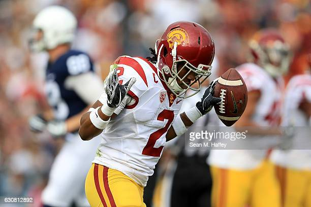 Defensive back Adoree' Jackson of the USC Trojans reacts after intercepting a pass during the first quarter against the Penn State Nittany Lions...