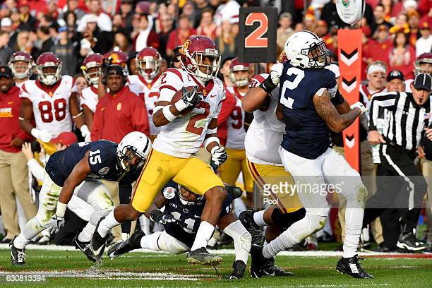 Defensive back Adoree' Jackson of the USC Trojans runs with the ball in the first half against the Penn State Nittany Lions during the 2017 Rose Bowl...