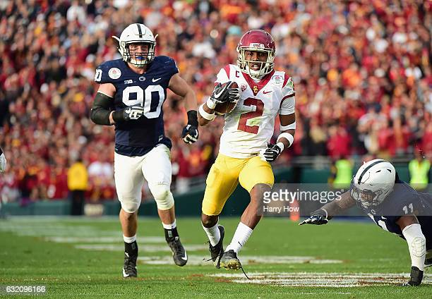 Defensive back Adoree' Jackson of the USC Trojans runs with the ball against the Penn State Nittany Lions during the 2017 Rose Bowl Game presented by...