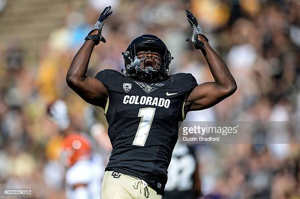 Defensive back Afolabi Laguda of the Colorado Buffaloes throw his hands in the air in frustration after nearly interception a pass against the Idaho...