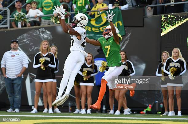 Defensive back Ahkello Witherspoon of the Colorado Buffaloes intercepts a pass intended for wide receiver Darren Carrington II of the Oregon Ducks...