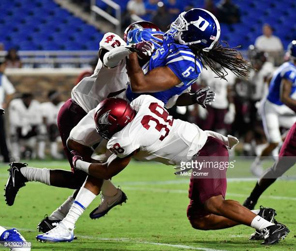 Defensive back Anthony Sherrill and defensive back Daryl Smith of the North Carolina Central Eagles tackle running back Nicodem Pierre of the Duke...