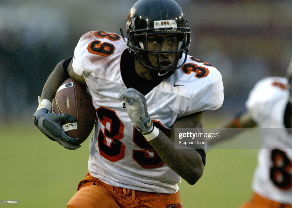 Defensive back Brandon Browner of the Oregon State Beavers returns an interception for a touchdown against the USC Trojans on December 6 2003 at the...