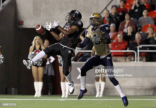 Defensive back Brandyn Thompson of the Ottawa Redblacks knocks down a pass intended for slotback Aaron Kelly of the Winnipeg Blue Bombers during a...