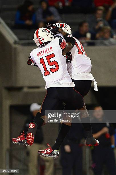 Defensive back Brian Allen of the Utah Utes celebrates with teammate defensive back Dominique Hatfield after Allen intercepts the football in the...