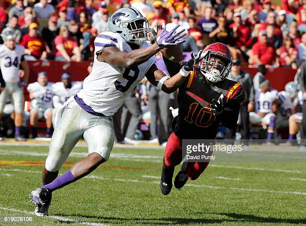 Defensive back Brian Peavy of the Iowa State Cyclones breaks up a pass meant for wide receiver Byron Pringle of the Kansas State Wildcats in the...