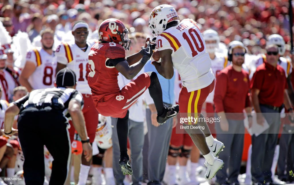 Defensive back Brian Peavy #10 of the Iowa State Cyclones breaks up a pass to wide receiver Marquise Brown #5 of the Oklahoma Sooners at Gaylord Family Oklahoma Memorial Stadium on October 7, 2017 in Norman, Oklahoma. Iowa State defeated Oklahoma 38-31.