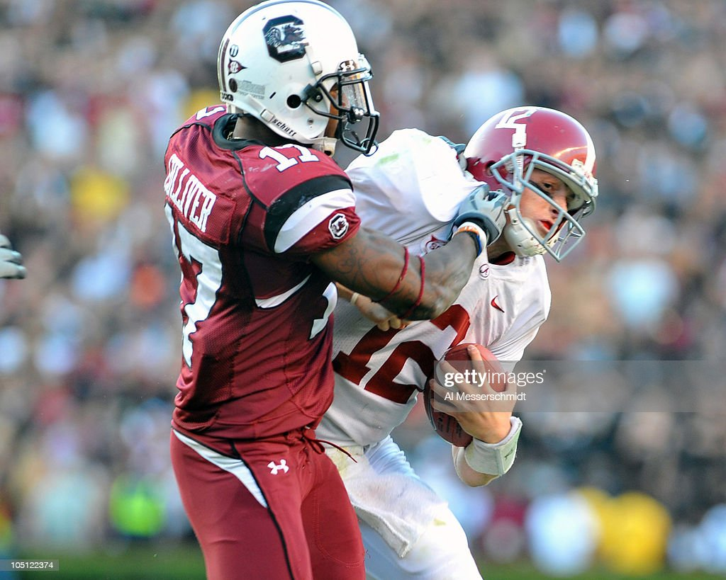 Defensive back Chris Culliver #17 of the Carolina Gamecocks tackles quarterback <a gi-track='captionPersonalityLinkClicked' href=/galleries/search?phrase=Greg+McElroy&family=editorial&specificpeople=5534586 ng-click='$event.stopPropagation()'>Greg McElroy</a> of the Alabama Crimson Tide October 9, 2010 at Williams-Brice Stadium in Columbia, South Carolina.