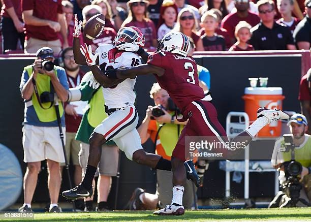 Defensive back Chris Lammons of the South Carolina Gamecocks breaks up a pass intended for wide receiver Isaiah McKenzie of the Georgia Bulldogs...