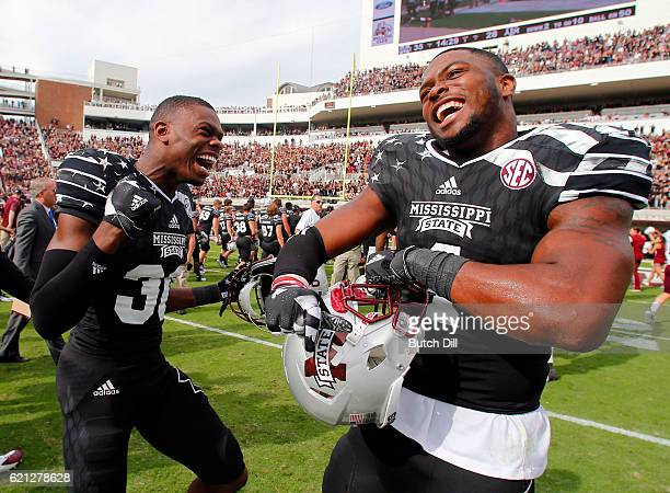 Defensive back Chris Stamps of the Mississippi State Bulldogs celebrates with linebacker Gerri Green of the Mississippi State Bulldogs after the end...