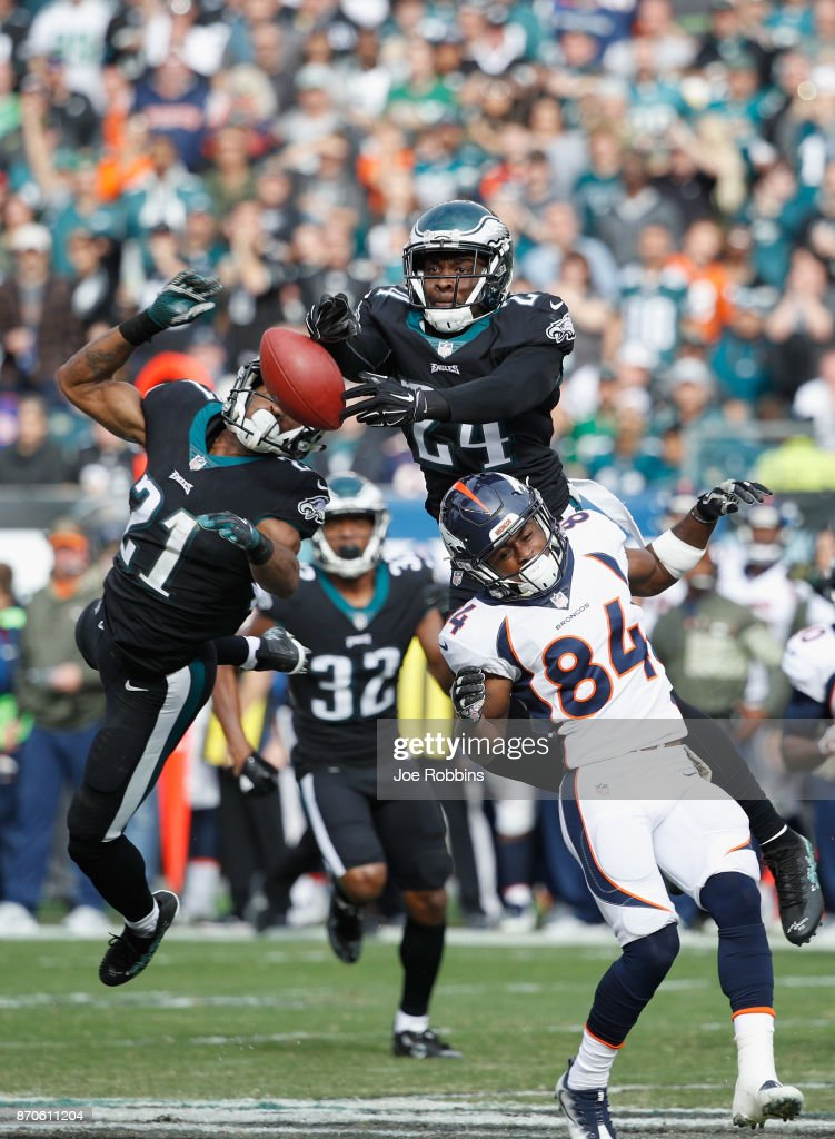 Defensive back Corey Graham #24 and cornerback Patrick Robinson #21 of the Philadelphia Eagles reach for an incomplete pass against the Denver Broncos during the second quarter at Lincoln Financial Field on November 5, 2017 in Philadelphia, Pennsylvania.