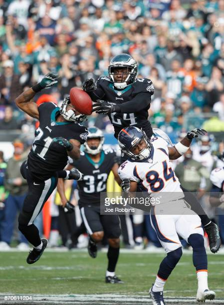 Defensive back Corey Graham and cornerback Patrick Robinson of the Philadelphia Eagles reach for an incomplete pass against the Denver Broncos during...
