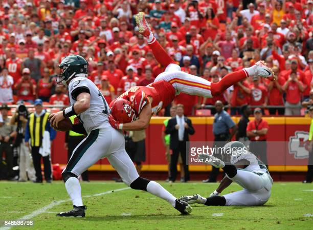 Defensive back Daniel Sorensen of the Kansas City Chiefs leaps to make a sack attempt on quarterback Carson Wentz of the Philadelphia Eagles during...