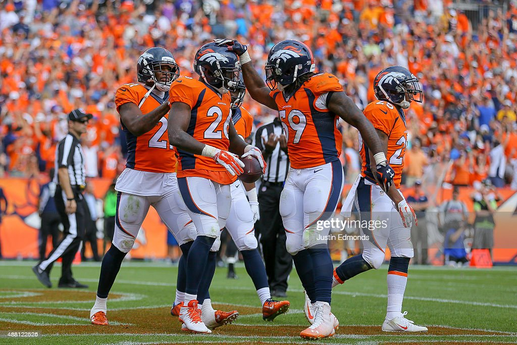 Defensive back Darian Stewart #26 of the Denver Broncos celebrates with Danny Trevathan #59 and Aqib Talib #21 after making a game-ending interception in the fourth quarter of a game at Sports Authority Field at Mile High on September 13, 2015 in Denver, Colorado.