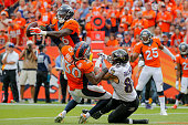 Defensive back Darian Stewart of the Denver Broncos makes a gameending interception in the end zone of a pass intended for tight end Crockett...