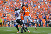 Defensive back Darian Stewart of the Denver Broncos makes a gameending interception on a pass intended for tight end Crockett Gillmore of the...