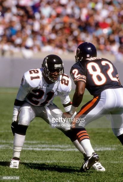Defensive back Deion Sanders of the Atlanta Falcons in action guarding Wide receiver Wendell Davis of the Chicago Bears November 11 1990 during an...