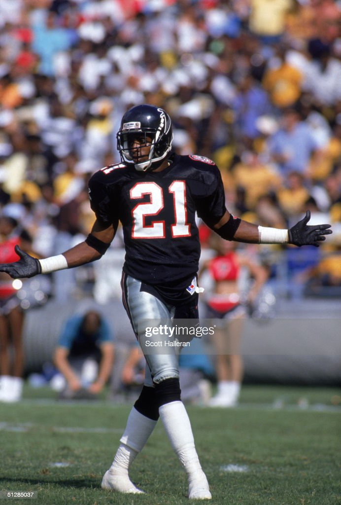 Defensive back Deion Sanders of the Atlanta Falcons walks on the field during a game against the New Orleans Saints at Atlanta Fulton County Stadium...