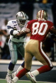 Defensive back Deion Sanders of the Dallas Cowboys in action guarding wide receiver Jerry Rice of the San Francisco 49ers November 12 1995 during an...