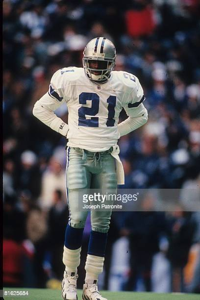 Defensive back Deion Sanders of the Dallas Cowboys waits between plays against the Philadelphia Eagles at Texas Stadium in the 1995 NFC Divisional...