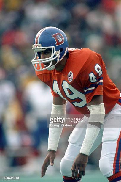 Defensive back Dennis Smith of the Denver Broncos looks on from the field during a game against the Buffalo Bills at Rich Stadium on October 21 1984...