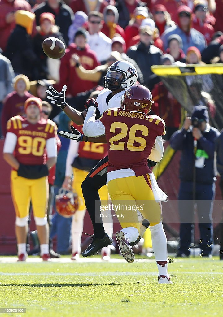 Defensive back Deon Broomfield #26 of the Iowa State Cyclones breaks up a pass meant for wide receiver Josh Stewart #5 of the Oklahoma State Cowboys in the first half of play at Jack Trice Stadium on October 26, 2013 in Ames, Iowa. The Oklahoma State Cowboys defeated the Iowa State Cyclones 58-27.