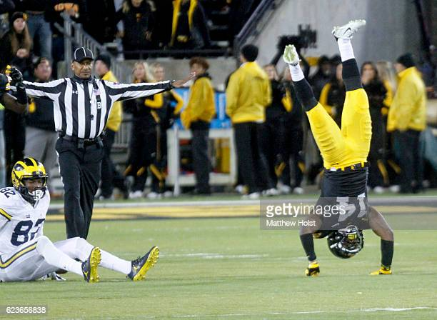 Defensive back Desmond King of the Iowa Hawkeyes does a handstand after missing an interception during the third quarter against the Michigan...