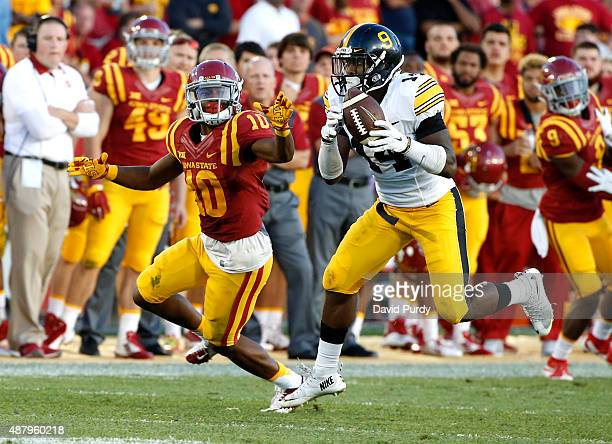 Defensive back Desmond King of the Iowa Hawkeyes intercepts a pass intended for wide receiver Jauan Wesley of the Iowa State Cyclones in the second...
