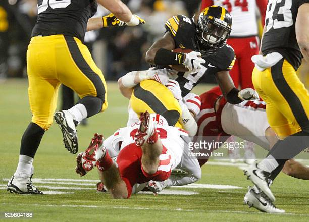 Defensive back Desmond King of the Iowa Hawkeyes is brought down by defensive back JoJo Domann of the Nebraska Huskers during the third quarter on...