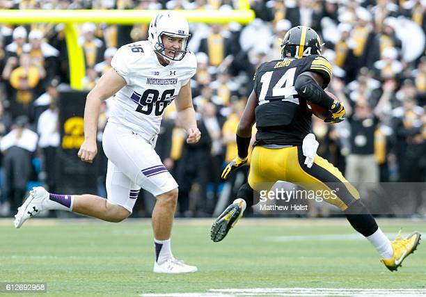 Defensive back Desmond King of the Iowa Hawkeyes is chased down during the second quarter by punter Hunter Niswander of the Northwestern Wildcats on...