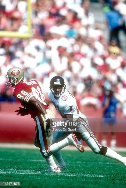 Defensive back Dion Sanders of the Atlanta Falcons guards Mike Sherrard of the San Francisco 49ers during an NFL football game September 23 1990 at...
