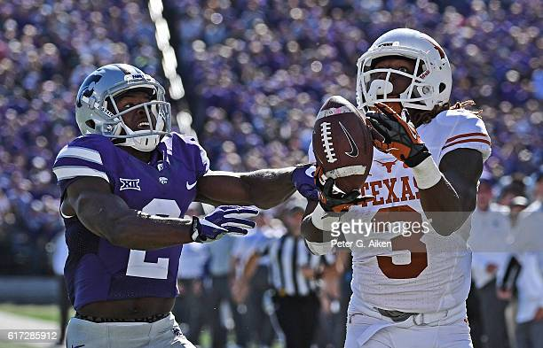 Defensive back DJ Reed of the Kansas State Wildcats brakes up a pass intended for wide receiver Armanti Foreman of the Texas Longhorns in the end...