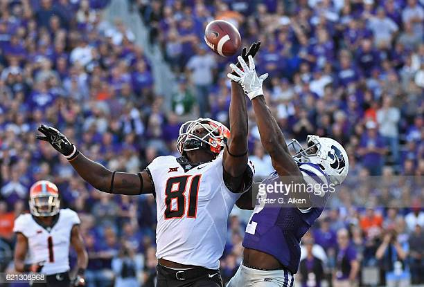 Defensive back DJ Reed of the Kansas State Wildcats intercepts the pass from wide receiver Jhajuan Seales of the Oklahoma State Cowboys during the...