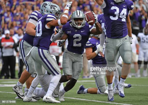 Defensive back DJ Reed of the Kansas State Wildcats reacts after recovering a fumble against the TCU Horned Frogs during the first half on October 14...
