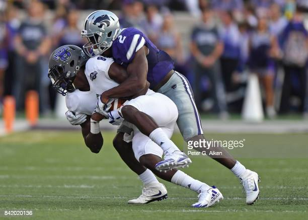 Defensive back DJ Reed of the Kansas State Wildcats tackles wide receiver Brandon Myers of the Central Arkansas Bears during the first half at Bill...