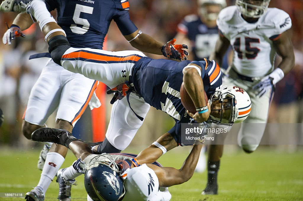 Defensive back D'Joun Smith #21 of the Florida Atlantic Owls flips quarterback Nick Marshall #14 of the Auburn Tigers during the first quarter of play on October 26, 2013 at Jordan-Hare Stadium in Auburn, Alabama. At the end of the first quarter Auburn leads Florida Atlantic 21-0.