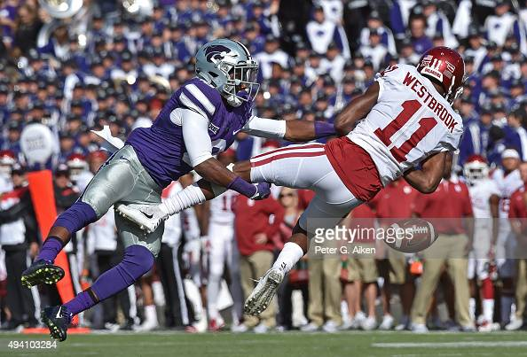 Defensive back Duke Shelley of the Kansas State Wildcats brakes up a pass intended for wide receiver Dede Westbrook of the Oklahoma Sooners during...