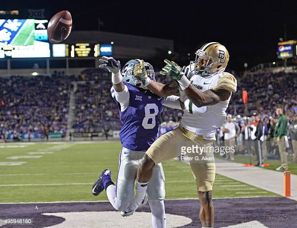 Defensive back Duke Shelley of the Kansas State Wildcats brakes up a pass in the end zone intended for wide receiver Corey Coleman of the Baylor...