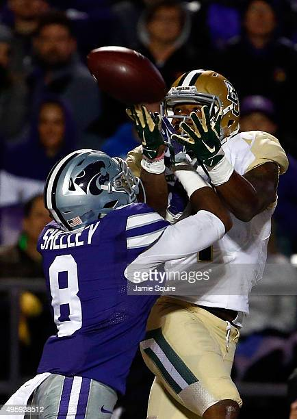 Defensive back Duke Shelley of the Kansas State Wildcats breaks up a pass intended for wide receiver Corey Coleman of the Baylor Bears during the 2nd...
